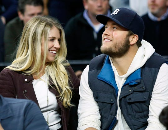 Lions quarterback Matthew Stafford, right, has been helping his wife, Kelly, while she prepared for surgery and recovery from a brain tumor.