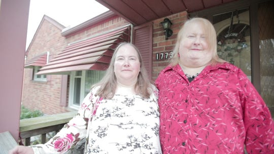 Aimee Stephens, at right, and wife Donna. Stephens, who is transgender, has argued that her firing by a funeral home outside Detroit violated federal law barring sex discrimination in the workplace.