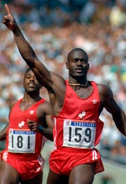 Canada's Ben Johnson gives a No. 1 sign after setting a world record for the men's 100-meter and winning a gold medal in the Seoul Summer Olympics in this Sept. 24, 1988 photo.  The time was 9.79 seconds. Olympic officials later stripped Johnson of his gold medal and world record at the games in Seoul, after he tested positive for steroids.