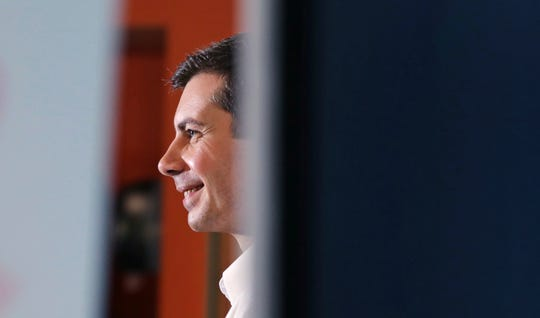 Democratic presidential candidate South Bend Mayor Pete Buttigieg smiles as he answers questions from employees during a campaign stop at a dairy company in Londonderry, N.H., Friday, April 19, 2019.