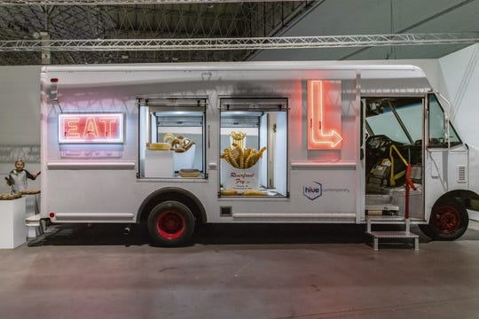 Chicago Artist John Miller is known for making life-sized glass food art shaped like hot dogs, french fries and donuts. His Food A Rama food truck will be part of the 47th Annual Glass Invitational at Habatat Galleries in Royal Oak.