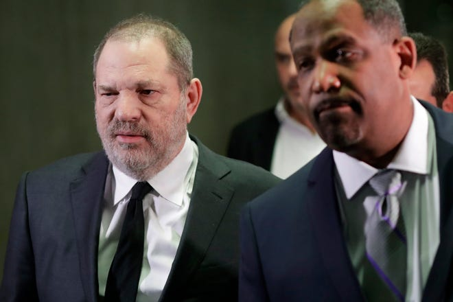 In this Jan. 25, 2019, file photo, Harvey Weinstein, left, leaves court with attorney Ron Sullivan in New York.