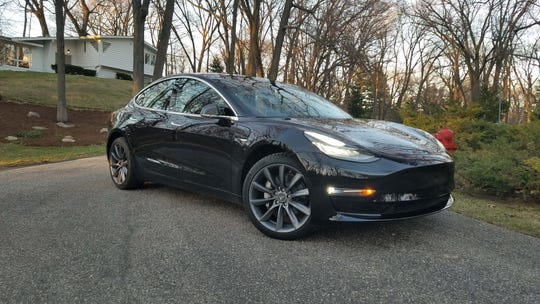Detroit News auto critic Henry Payne took delivery on his Tesla Model 3 in October, 2018 for $57,500. To upgrade to Tesla's latest computer chip, he would need to pay an additional $5000.