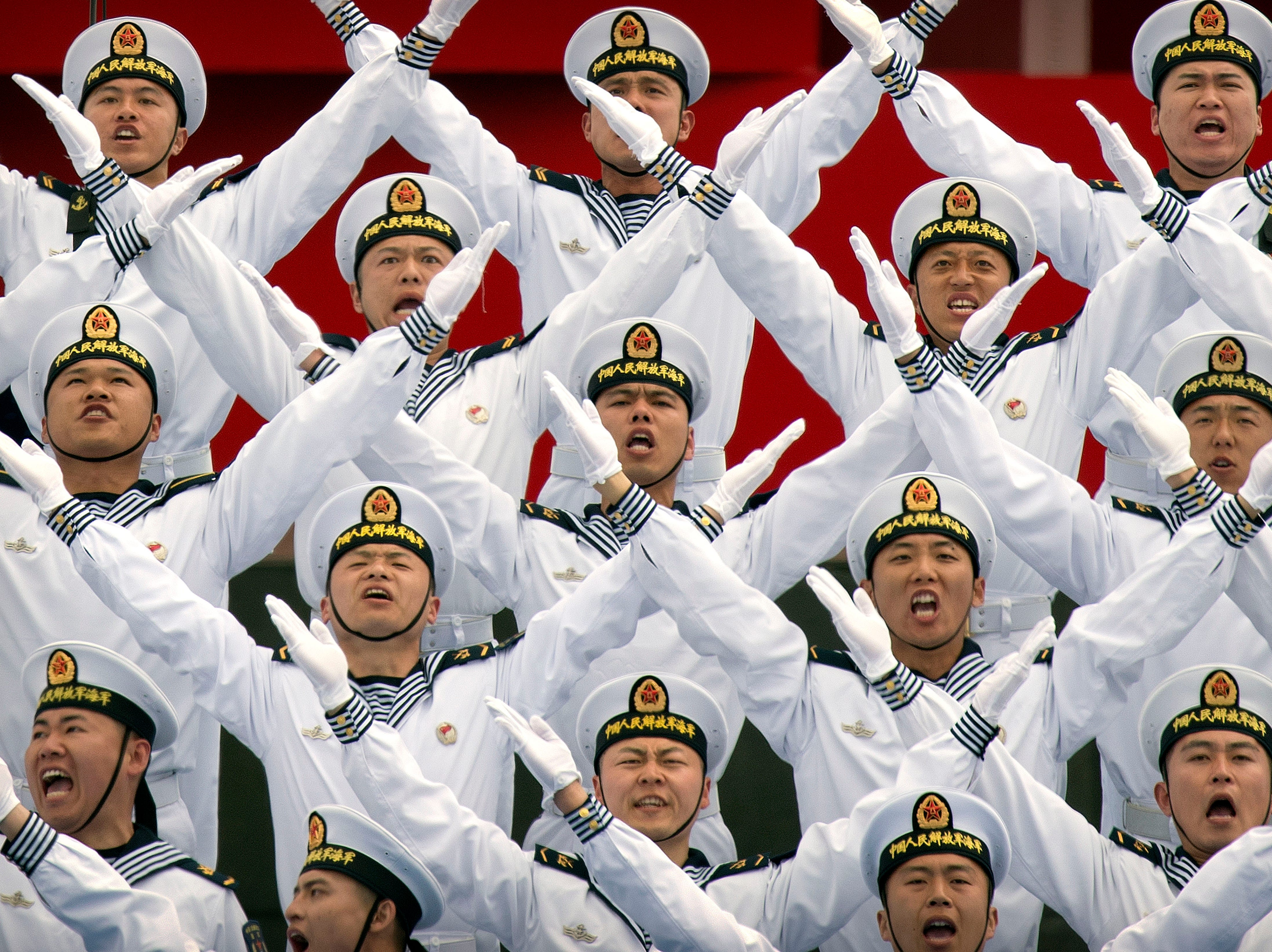 A Chinese navy chorus performs during a concert featuring Chinese and foreign military bands in Qingdao, Monday, April 22, 2019. Ships from Chinese and foreign navies have gathered in Qingdao for events this week, including a naval parade, to mark the 70th anniversary of the founding of the People's Liberation Army (PLA) Navy.