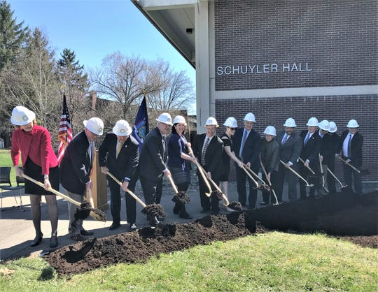 SUNY Corning Community College President Katherine Douglas, left, joins state and local government and business leaders in a ceremonial groundbreaking for a new innovation center.