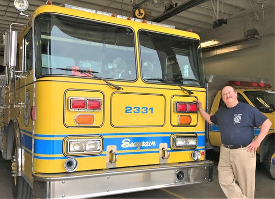 Jim Carozza, longtime member and former president of the West Elmira Fire Department, shows off one of the fire trucks that will be on display during an open house this weekend.