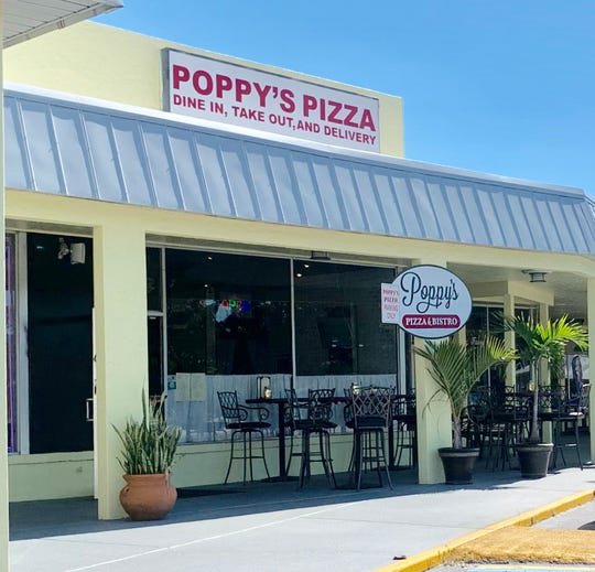 Poppy's Pizza & bistro, closed since last week after the arrest of a co-owner for possessing child pornography, reopened Monday afternoon.