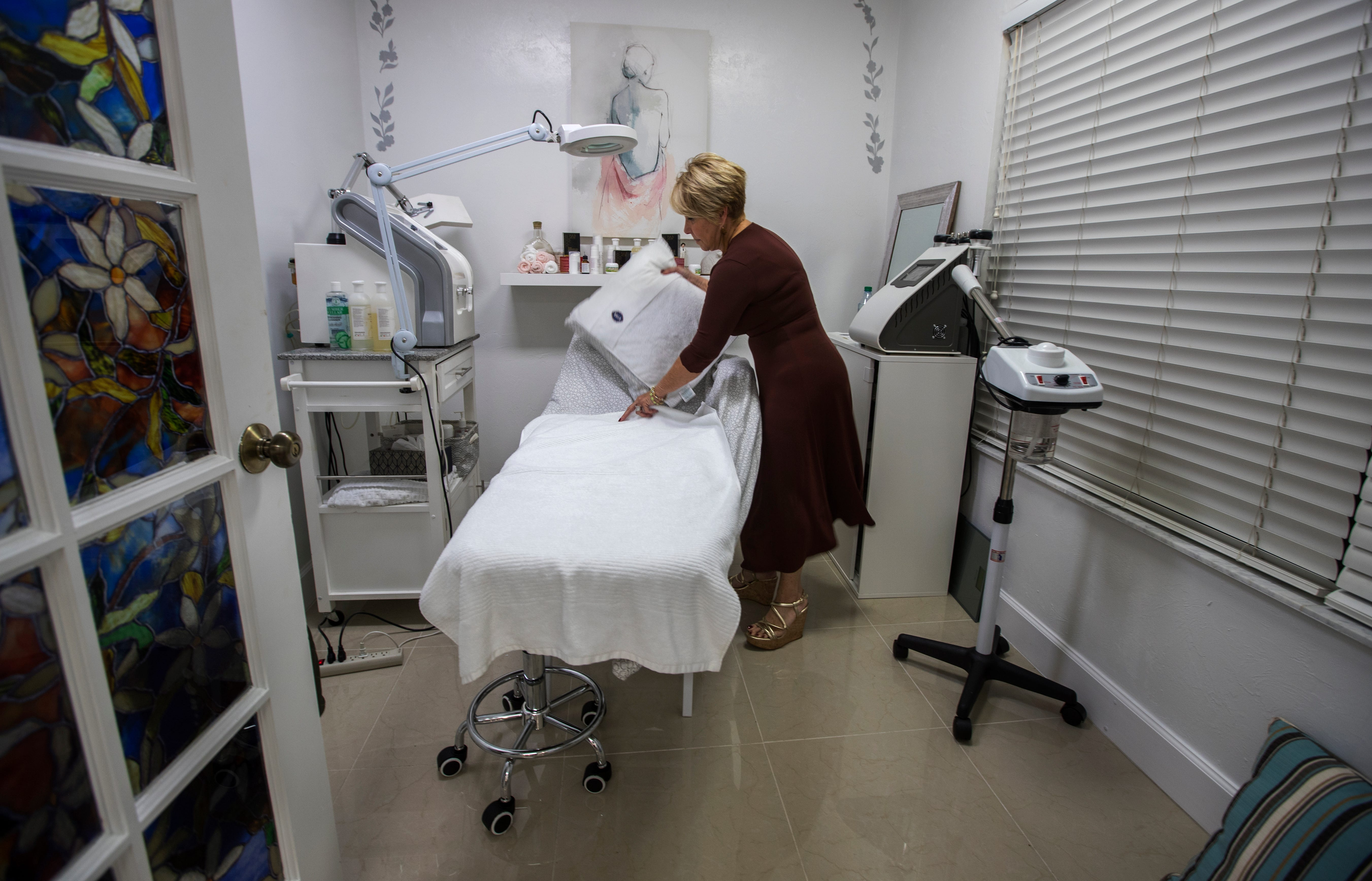 Reina Vogeler, an aesthetician, arranges her work area on Tuesday, April 16 at the Bouquet Beauty Salon in Naples. The business has been open since August 2018. In June 2017, the Florida Department of Law Enforcement raided the previous tenant at this location, Asian Massage of Naples.