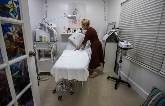 Reina Vogeler, an aesthetician, arranges her work area Tuesday, April 16, 2019 at the Bouquet Beauty Salon in Naples. The business is located at 5007 Tamiami Trail East, and has been open since August of 2018. The previous tenant at this location, working under the name Asian Massage of Naples, was raided by Florida Department of Law Enforcement on June 2017.
