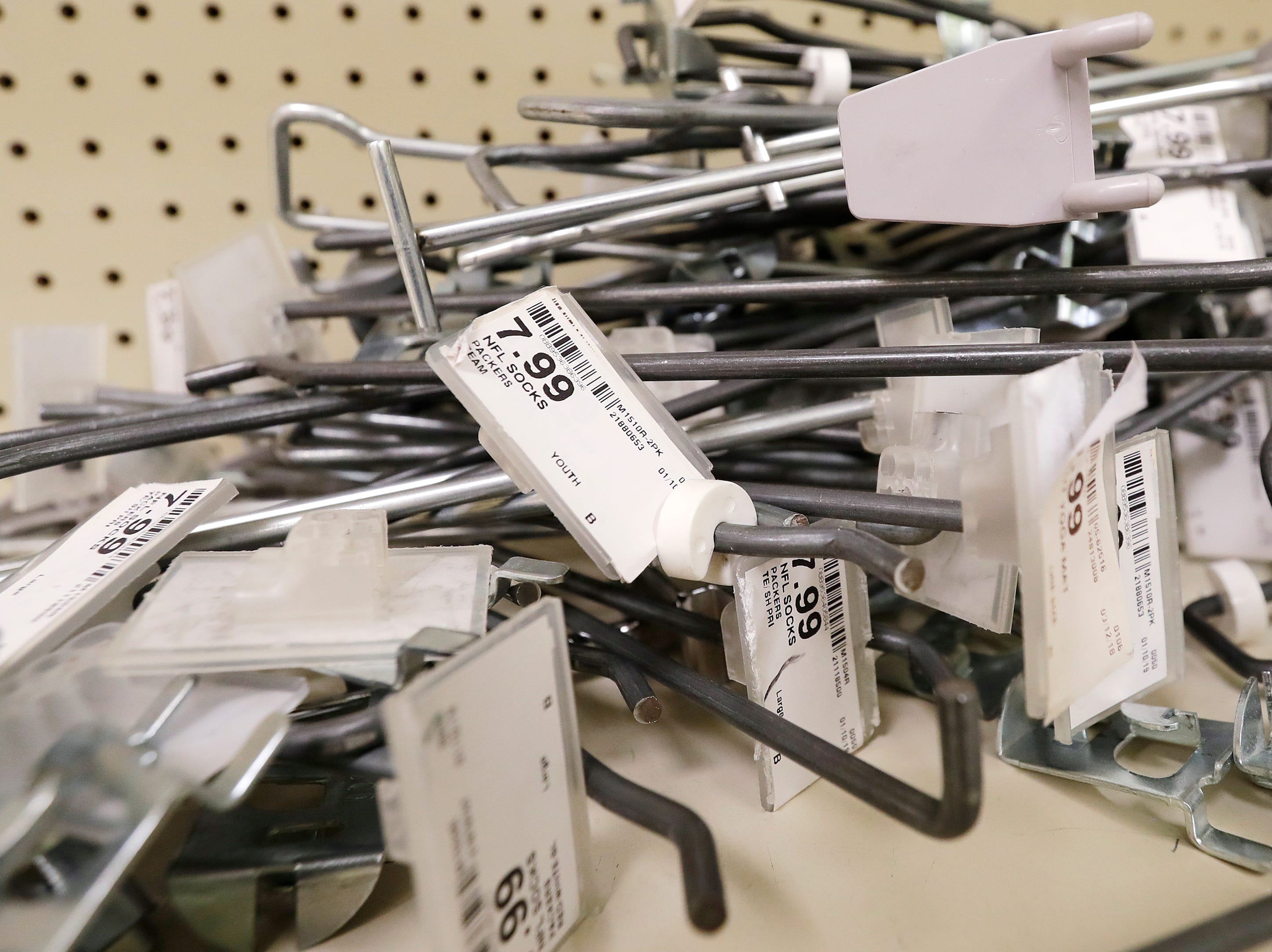 A pile of price tags sit on an empty shelf on the final day of business at the Shopko on Military Ave on Monday, April 22, 2019 in Green Bay, Wis.