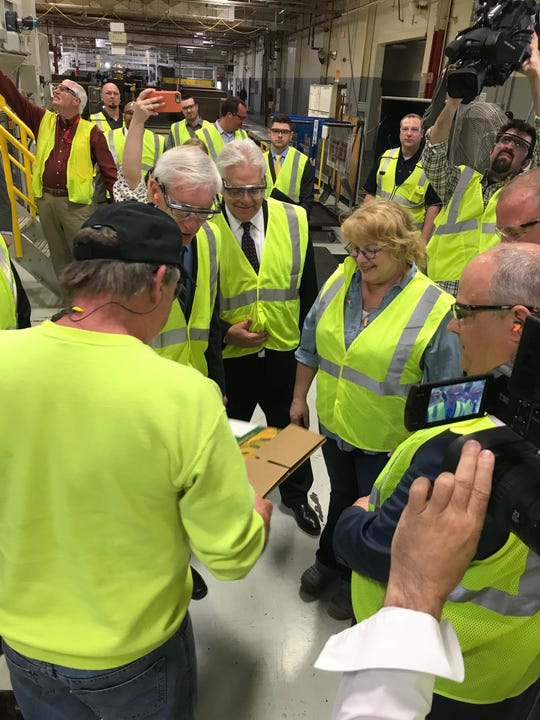 Deb Carey, founder and president of New Glarus Brewing, toured Menasha Packaging in Neenah where 24-pack can containers are made for Spotted Cow.