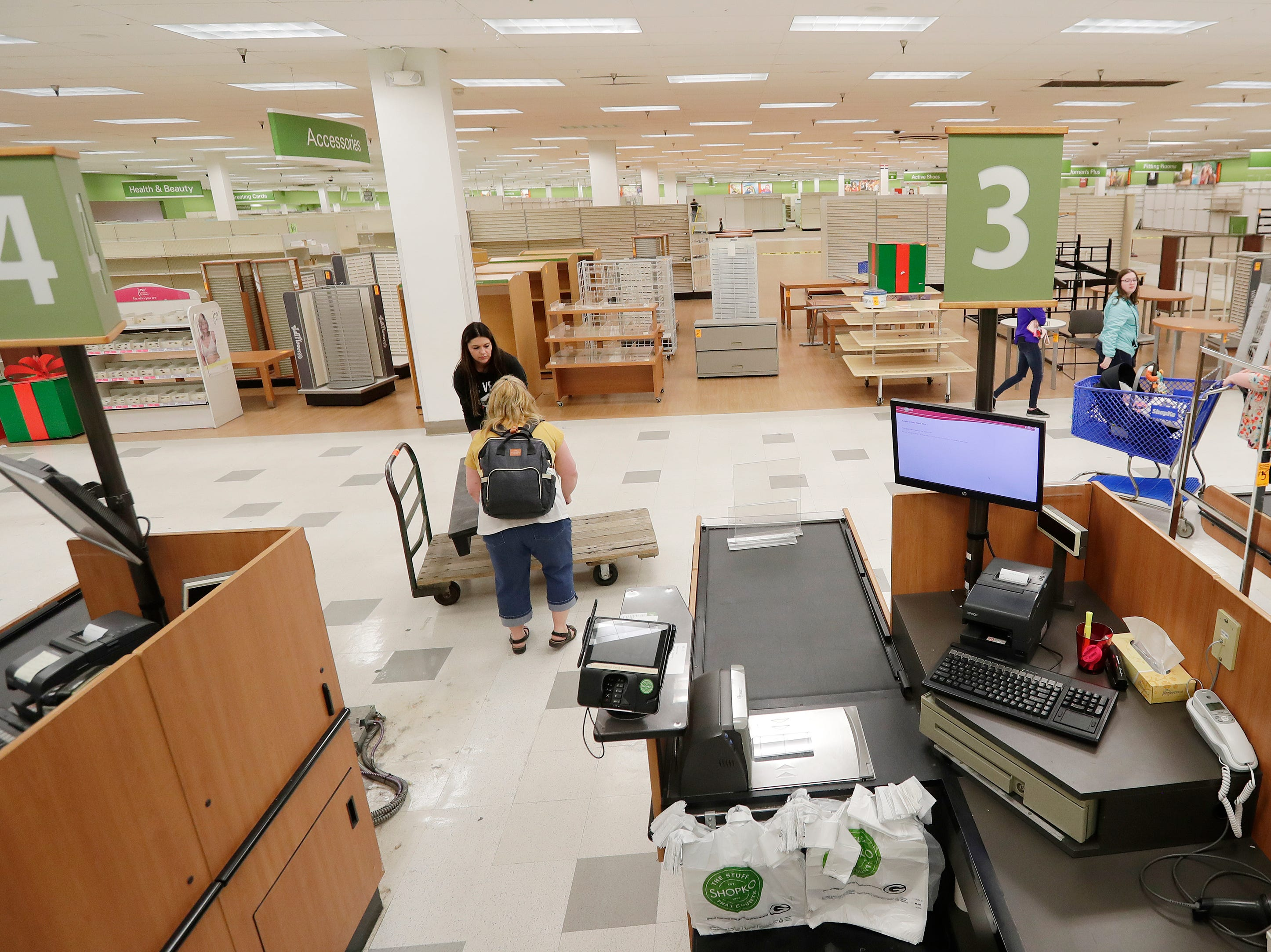 Customers purchase store fixtures on the final day of business at the Shopko on Military Ave on Monday, April 22, 2019 in Green Bay, Wis.