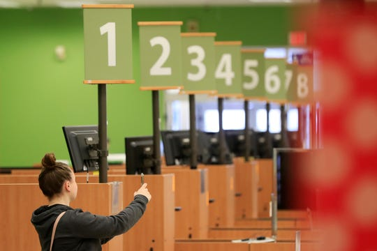 A customer takes a photo of the interior of the store on the final day of business at the Shopko on Military Avenue in Green Bay. The store was the company's first to open.