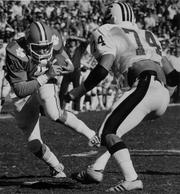 Clemson quarterback Steve Fuller picks up yardage against South Carolina in 1978.