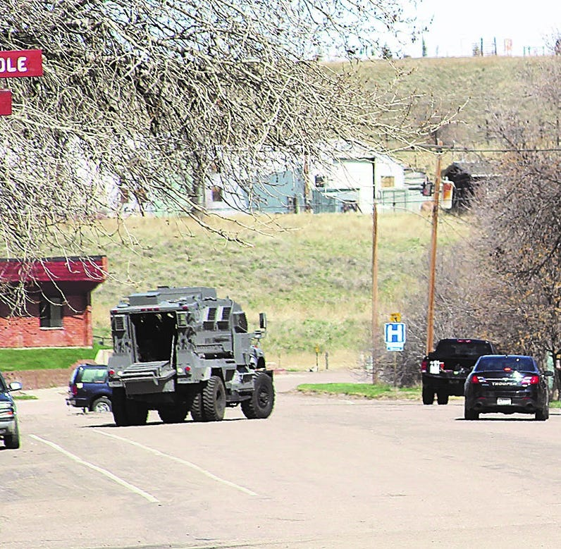 Great Falls officer was shot in Shelby standoff; another injured
