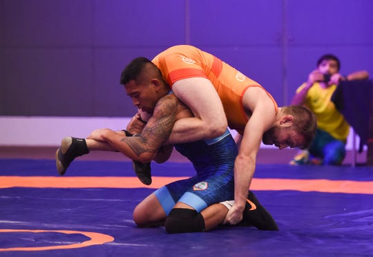Wrestlers compete for top spots during the second day of matches in the United World Wrestling Oceania Championships Yona 2019 at LeoPalace Resort Guam on April 21, 2019.