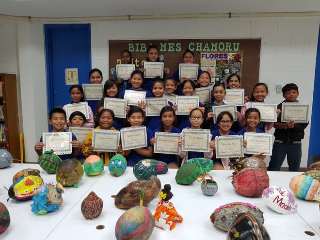 The students of M.U. Lujan Elementary School received certificated of appreciation for their continued support in promoting and perpetuating the CHamoru culture, they performed chants, songs and dances at the Guam Premier Outlet. Front row from left to right: Davyn Paet; Ryan Pereda; Emien Sikaan; Sabrina Santos; Elleanna Vegafria; Denise Aguon;Myalena Paet; and Hailee Hernandez. Middle row, left to right: LeShael Taimanglo; Chassidy Fernandez; Kaylee Afaisen; Cienna Agustin; Madison Quenga; Essence Gonzales; Joneva Quintanilla; Rylee Salas; Hanaya Gamboa; Persais Taitague; Tiara Naputi; and Ajay Tereyego. Back row, left to right: Angilyna Thineyog; Aveyani Babauta; and Abegail Balajadia.
