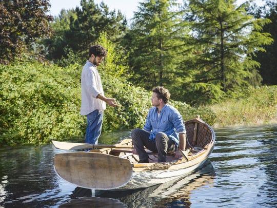 "Aviv Alush, left, portrays Jesus and Sam Worthington portrays Mack Phillips in 2017 film ""The Shack."""