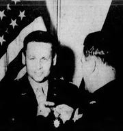 Lt. Col. William (Billy) Arnold, former Speedway race driver receives the legion of merit award fro Brig. Gen. Ott, commanding general at the Army Air Force base depot in England in 1944.