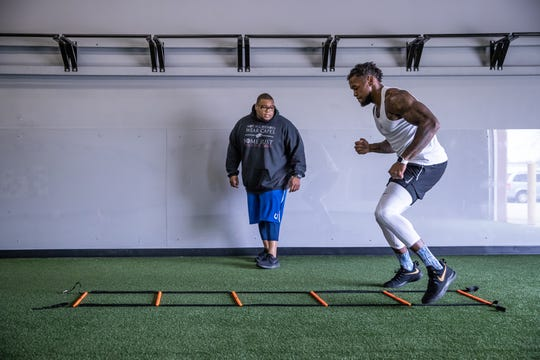 "Justin Brent (right) works through ladder drills with Larry Dorsey, a performance specialist at Sparx Athletic Refinery in Fishers, Ind., on Monday, April 22, 2019, days before the 2019 NFL Draft. Brent has been training in the Fishers gym since January. ""I don't want to let anybody down,"" said Brent. ""They've got me right, man. This is the place to be."""