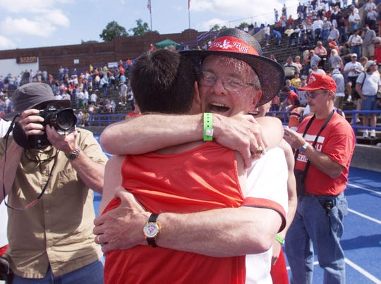 John Raffensperger hugs one of his athletes after he set a state record with his 10th state championship as a track and field coach. His City High teams won 10 Class 4-A titles between 1992 and 2002.