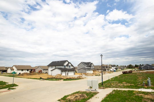 Construction continues on a neighborhood with two story homes and condos, Monday, April 22, 2019, along Franklin Street near Centennial Park in North Liberty, Iowa.