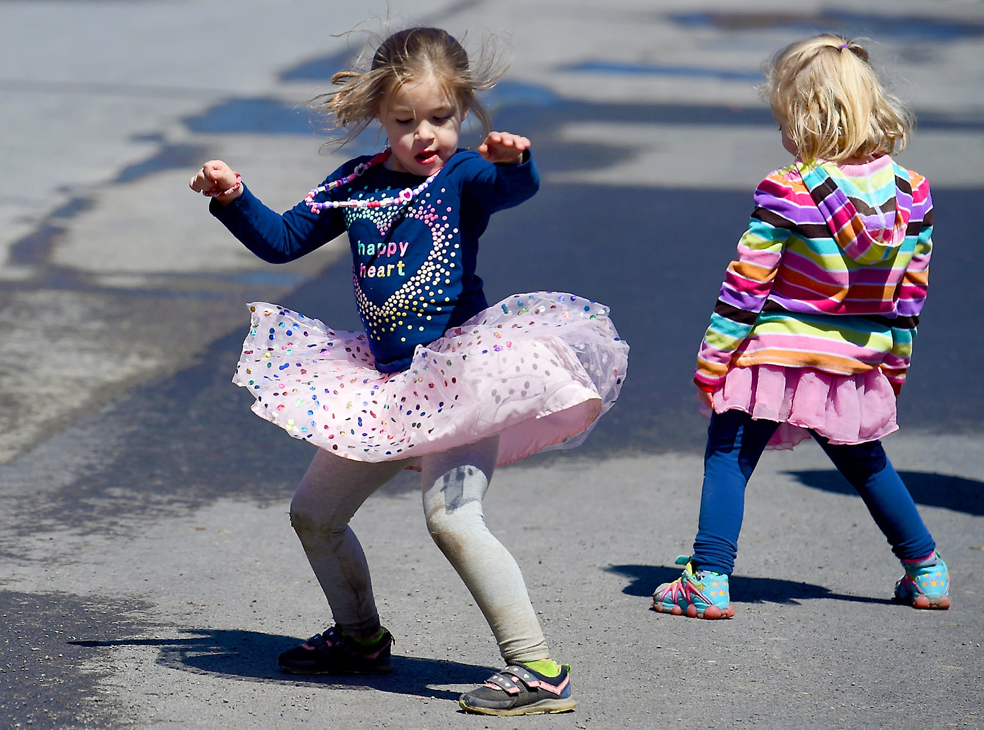 2018: Sophie Mallow, left, and Amelia O'Dell Welling, right, dance during the Tough Turtle, an annual obstacle course fun run to benefit Ithaca's Children's Garden, held on Saturday at the Cayuga Waterfront and Black Diamond Trails.