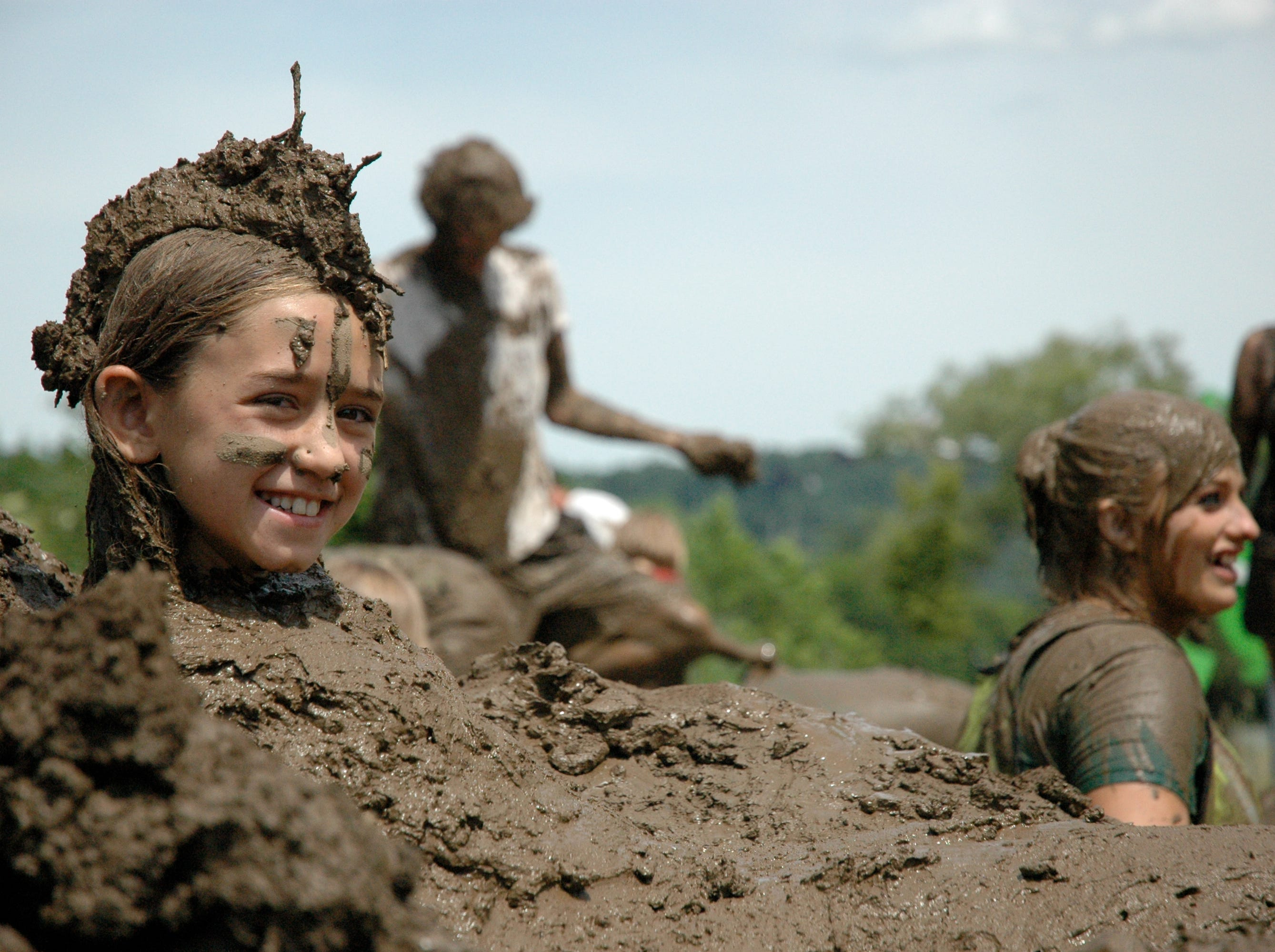 2012: Kids revel in the mud during the International Mud Day festivities in 2012 at the Ithaca ChildrenÕs Garden.