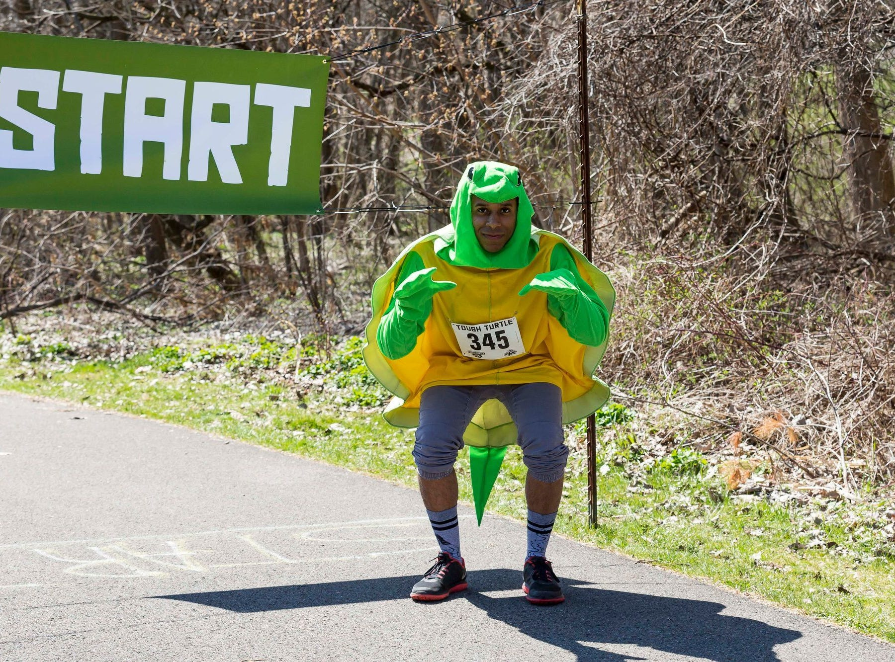2016: A participant at the 2016 Tough Turtle 5K, a fundraiser for the Ithaca ChildrenÕs Garden.