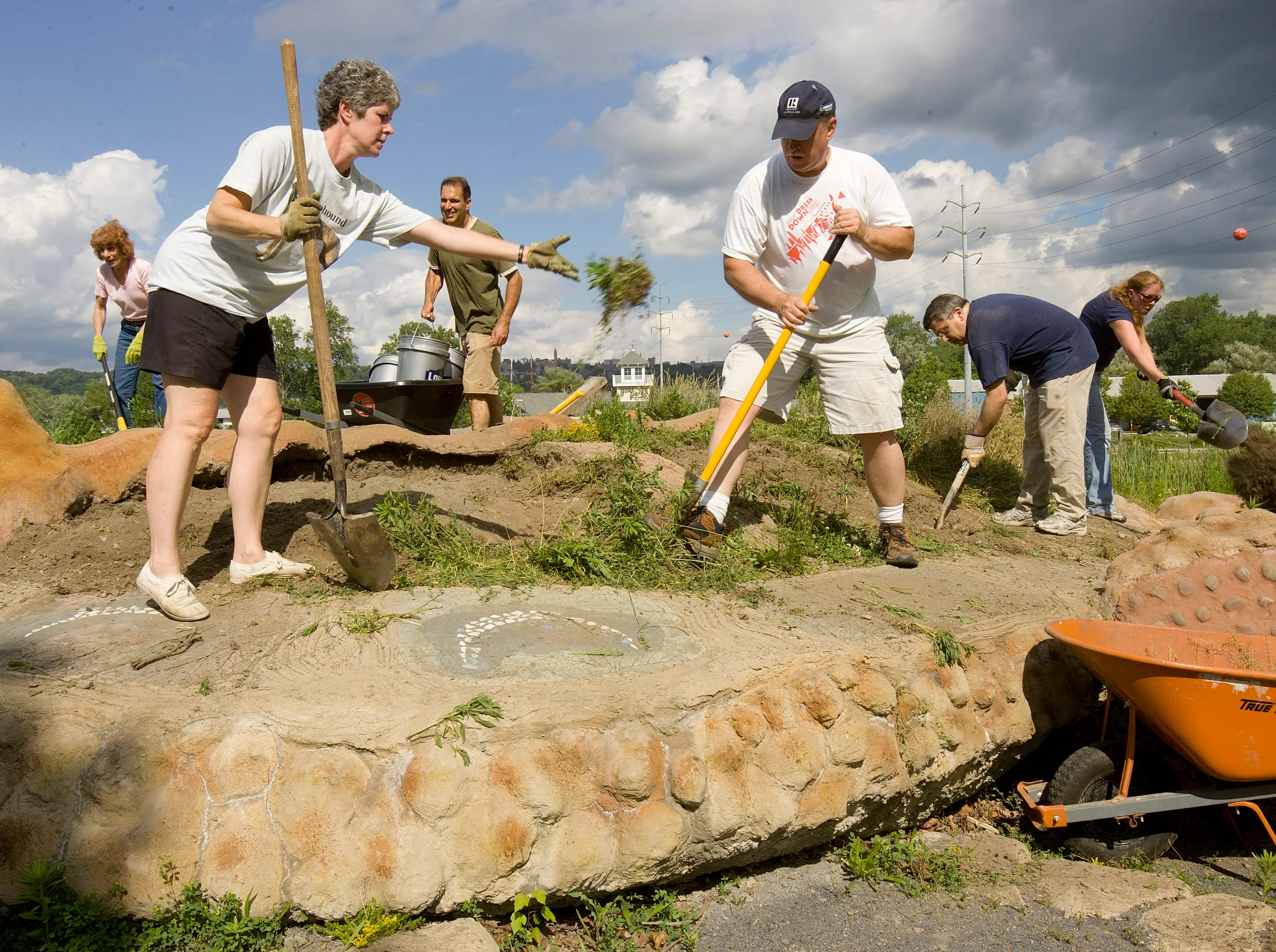 2010: Members of the Ithaca Board of Realtors work replace the plantings on Gaia the Turtle Thursday afternoon at the Ithaca Children's Garden in Cass Park in Ithaca.