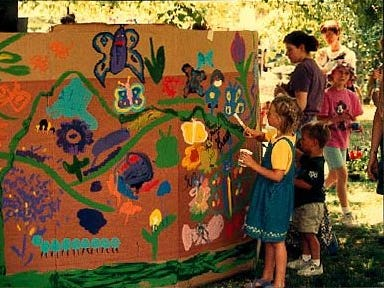 1999: Children paint a mural at an activity sponsored by the Ithaca Children's Garden at last year's festival.
