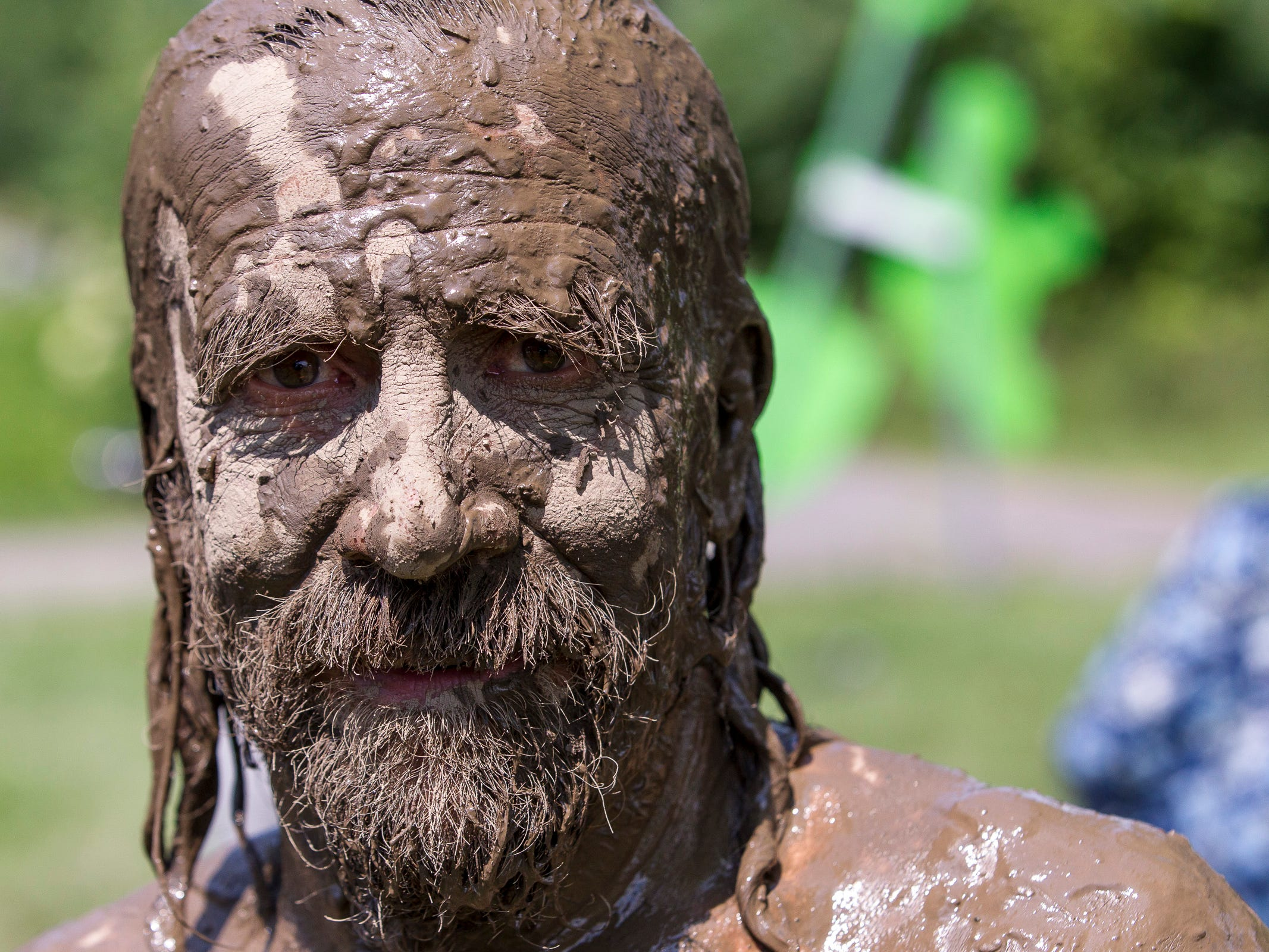 2013: The mud on the face of John Rogers of Ithaca begins to dry as he explores the Ithaca Childrens Garden Sunday during the International Mud Day celebration held at Cass park.