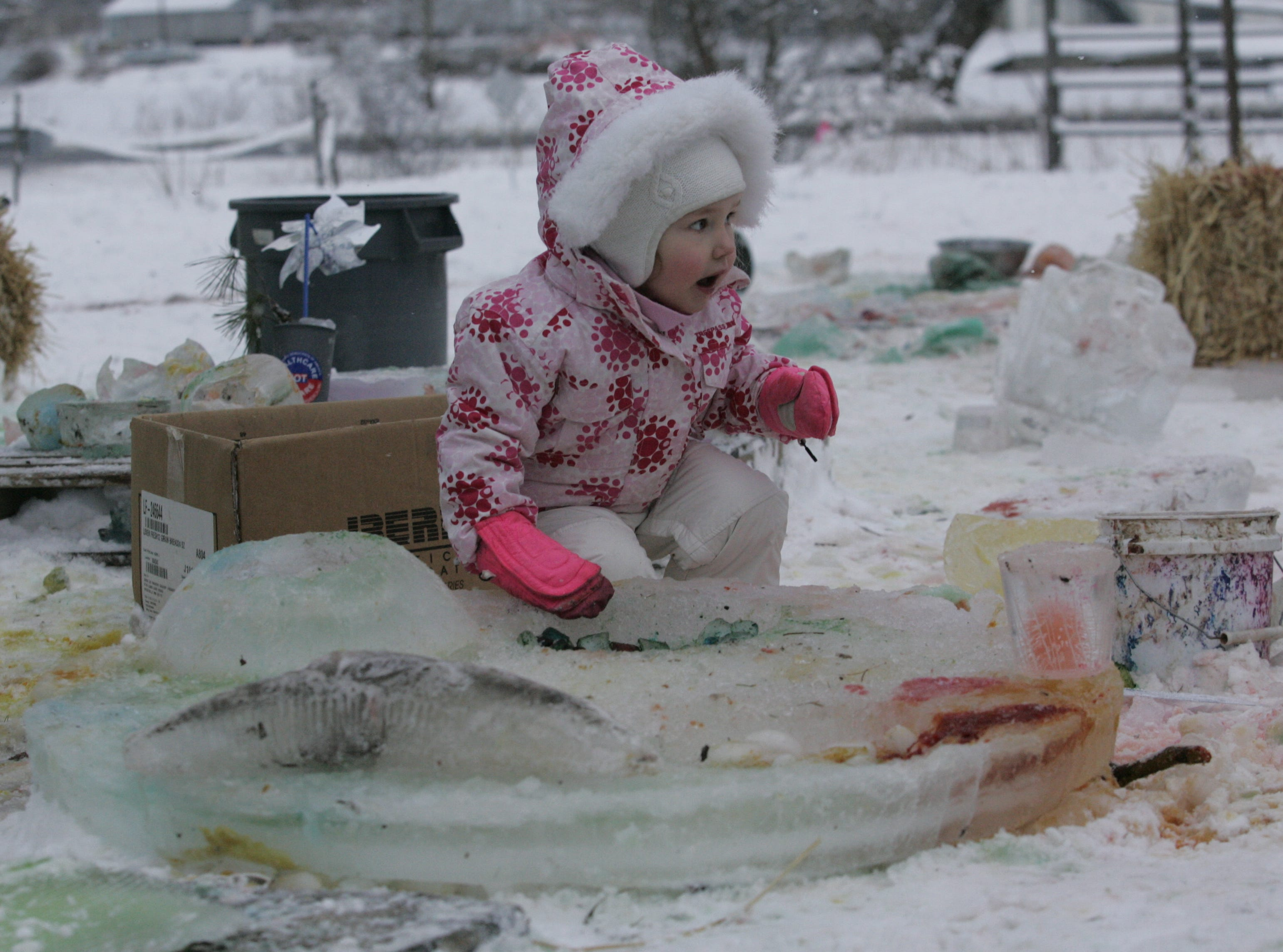 2013: Maggie Webb, 2, of Ithaca paints ice crystals during the Fire and Ice Festival Saturday at the Ithaca Children Garden.