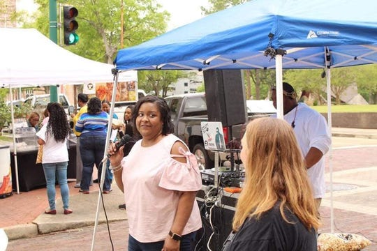 Sherry Wallace thanks everyone for coming at the opening ceremony at the first Foodie Friday Festival in downtown Jackson.