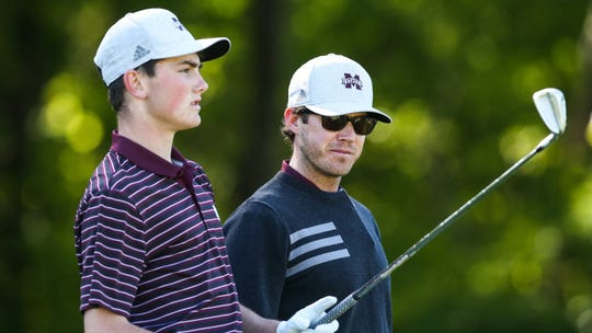 Mississippi State head coach Dusty Smith (right) says freshman Ford Clegg (left) has gotten better on and off the course during his first year at MSU.