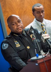 Jackson Police Chief James Davis, foreground, and Sgt. Roderick Holmes, announce the arrest of two individuals.
