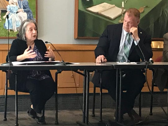Knoxville Mayor Madeline Rogero speaks Monday morning at Knoxville-Farragut-Knox County Growth Policy Plan Committee meeting called by Knox County Mayor Glenn Jacobs (right).
