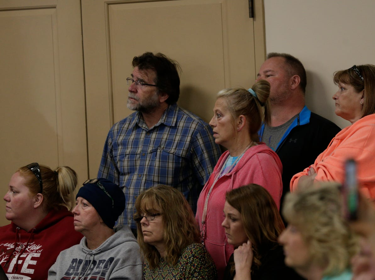 Family members react as Supt. Doug Carter of the Indiana State Police speaks during a press conference on an update on the Delphi murders investigation, Monday, April 22, 2019 at the Canal Center in Delphi. Abby Williams and Libby German, both Delphi eighth-graders, were murdered while hiking a popular community trail near Delphi on Feb. 13, 2017.