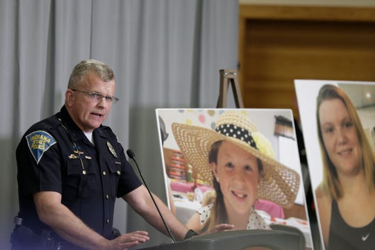 Supt. Doug Carter of the Indiana State Police, right, speaks during a press conference on an update on the Delphi murders investigation, Monday, April 22, 2019 at the Canal Center in Delphi. Abby Williams and Libby German, both Delphi eighth-graders, were murdered while hiking a popular community trail near Delphi on Feb. 13, 2017.