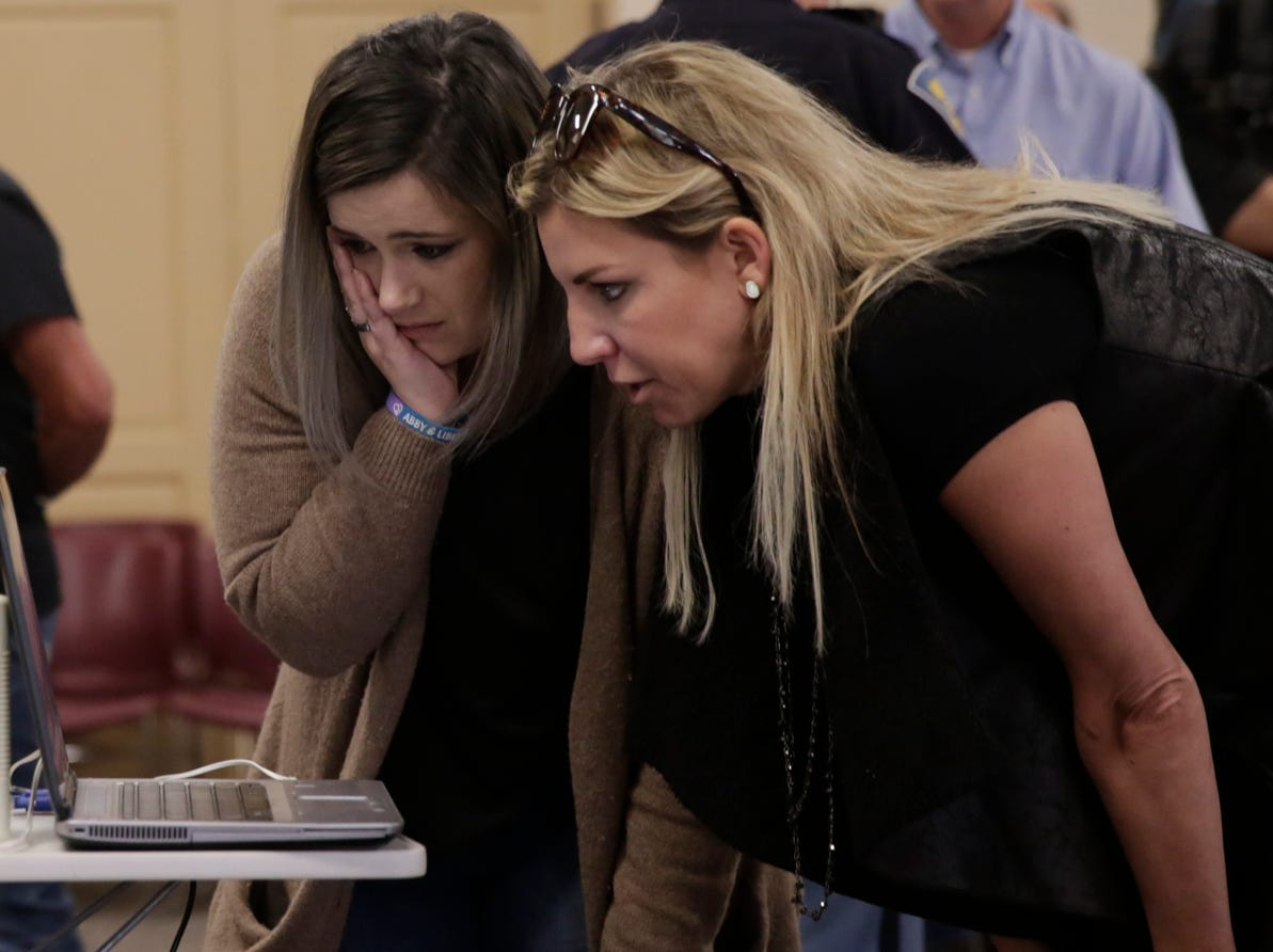 Megan Lang, left, of Toronto, Canada and Margot Clark of Carmel look at a video showing the suspect walking after a press conference on an update on the Delphi murders investigation, Monday, April 22, 2019 at the Canal Center in Delphi. Abby Williams and Libby German, both Delphi eighth-graders, were murdered while hiking a popular community trail near Delphi on Feb. 13, 2017.