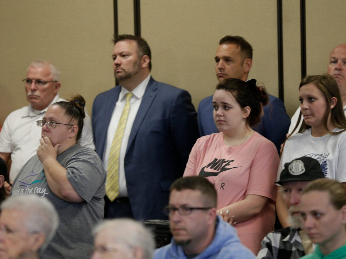 Community members react as Supt. Doug Carter of the Indiana State Police speaks during a press conference on an update on the Delphi murders investigation, Monday, April 22, 2019 at the Canal Center in Delphi. Abby Williams and Libby German, both Delphi eighth-graders, were murdered while hiking a popular community trail near Delphi on Feb. 13, 2017.