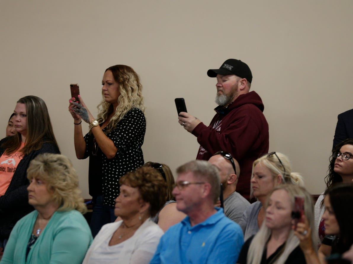 Community members film Supt. Doug Carter of the Indiana State Police as he speaks during a press conference on an update on the Delphi murders investigation, Monday, April 22, 2019 at the Canal Center in Delphi. Abby Williams and Libby German, both Delphi eighth-graders, were murdered while hiking a popular community trail near Delphi on Feb. 13, 2017.