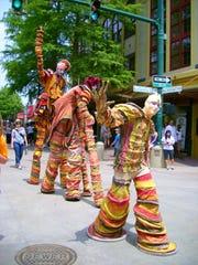 Stilt walkers at Festival International de Louisiane.