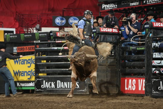 Valdiron de Oliveira attempts to ride Phenom Genetics's Hy Test during the first round of the Columbus PBR 25th Anniversary Unleash the Beast. Photo by Andy Watson