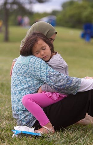 Livingston County ranked #1 in the state for child well-being, according to the newly released Kids Count in Michigan report. Naela Zughyer holds her daughter 4-year-old Selena near the launch field at the Michigan Challenge Balloonfest Sunday, June 24, 2018.