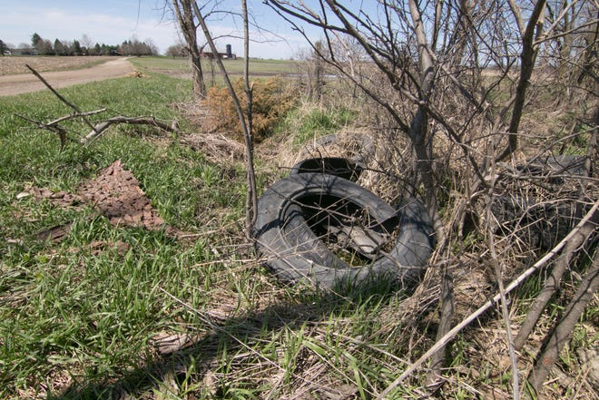 Van Buren Road west of Nicholson and Cedar roads in Handy Township, shown Monday, April 22, 2019, has been littered with dumping of mattresses, building materials and other debris.