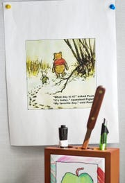 """This classic """"Winnie-the-Pooh"""" quote by A.A. Milne is pinned up at the desk of Michigan State executive associate athletic director Jim Pignataro's desk, encouraging him to embrace each day."""