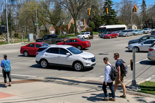 Vehicles and pedestrians navigate the intersection of Grand River Avenue and Hagadorn Road on Monday, April 22, 2019, in East Lansing. According to Michigan State Police statistics from 2017, the location is the second most accident-prone intersection in Ingham County.