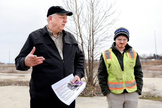 Dave Favero, deputy cleanup manager for the RACER sites, left, talks about the proposed 1,4 dioxane clean up  on Thursday, April 11, 2019, at the RACER Lansing Plant 2. At right, is Arcadis environmental specialist Daniel Stockard. The underground plume ofÊchemical pollution is creeping toward wells that supply some of the Lansing region'sÊdrinking water.