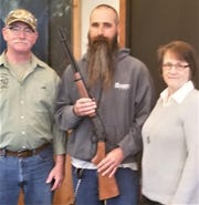 Viking Bow and Gun Club Hunter Safety Program recently received a donation of a 30/30 lever action rifle from the family of the late Jerry Luebke. Pictured from left; Jeff Lyon, lead hunter safety instructor at Viking, accepts the donated rifle from Jerry's son, Jeff Luebke, and his wife, Marilyn. Jerry was a long-time hunter safety instructor in Manitowoc County.